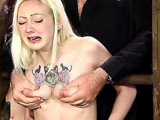 squeezing her boobs and she has a threesome