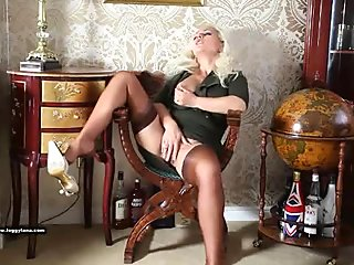 Horny blonde cougar housewife plays with big tits and pussy in sexy nylons