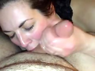 Cheating brunette wife sucking and stroking a long prick to