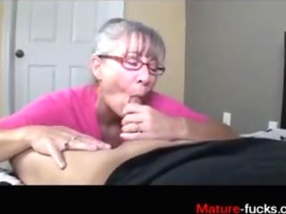 Mature mom with pearl necklace sucks down dick in a closeup