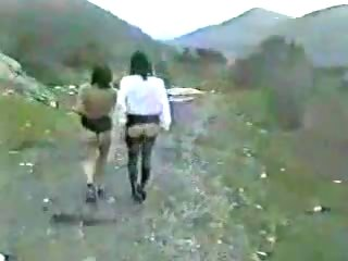 My lesbian wife with girl friend outdoor. Public nudity