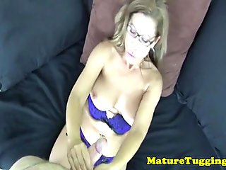 Busty amateur mature tugs cock in closeup pov