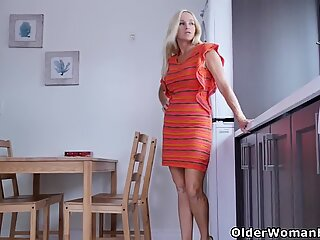 Canadian housewife Dani Dare rubs one out in the kitchen