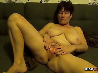 Busty milf plays with her lovely breasts
