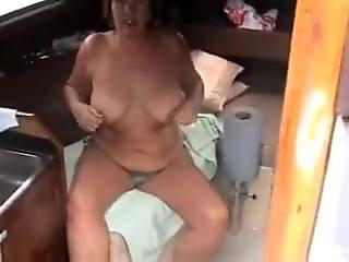 Busty woman i'd like to fuck in the sofa wearing sexy bikini and flashing tits
