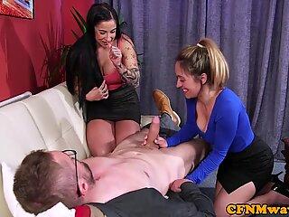Tattooed MILF tugging naked guys cock