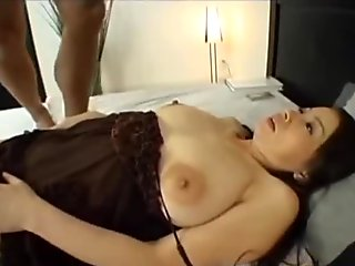 Busty mature woman fingering her